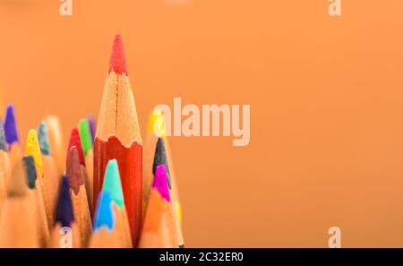 Back to school, Red pencil standing out from crowd, plenty business success concept