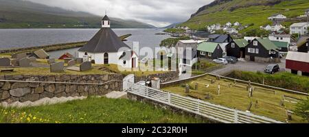 The small town of Haldarsvik with the octagonal church and view of the Atlantic, Faeroeer, Denmark