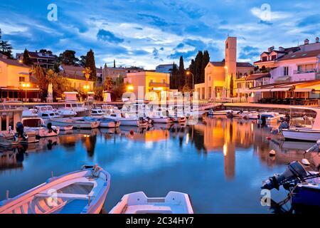 Krk. Town of Malinska waterfront and harbor dawn view, Krk island in Croatia - Stock Photo