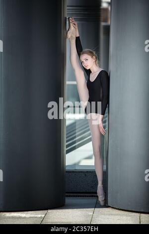 Young graceful ballerina in black bathing suit