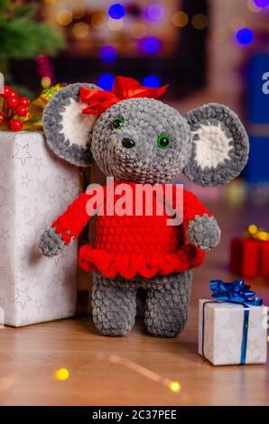 The plush mouse was given to children in the new year - Stock Photo