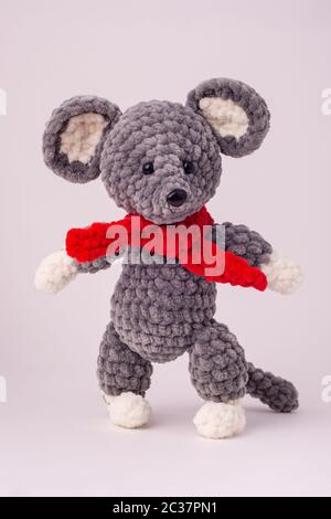 Funny knitted teddy mouse, white background - Stock Photo