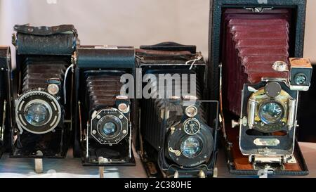 Photo the old photo cameras. Antique folding cameras