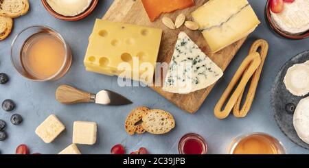 Cheese panorama. Blue cheese, Dutch cheese and others, with wine and bread, shot from the top - Stock Photo