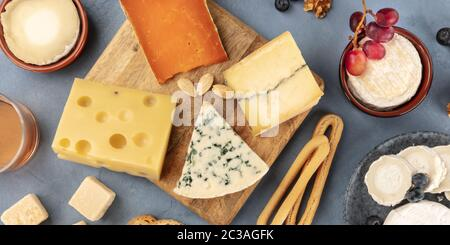 Cheese variety, top panoramic flat lay. Various cheeses, shot from the top - Stock Photo