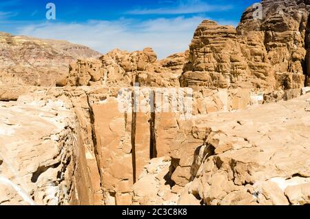 high rocky mountains against the blue sky and white clouds in the desert in Egypt Dahab South Sinai