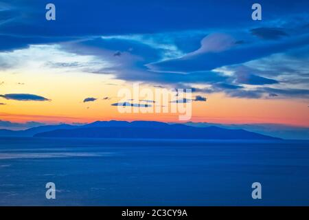 Kvarner bay and island of Krk on open sea at golden dawn view - Stock Photo