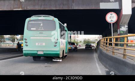Old, polluting bus on 68th street in Bogota, Colombia. Bridge; tunnel. A predominant means of transportation in the Latin, South American city.