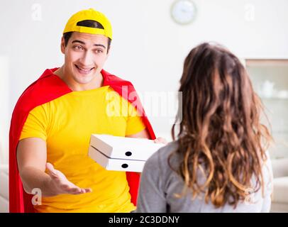 Superhero pizza delivery guy with red cover - Stock Photo