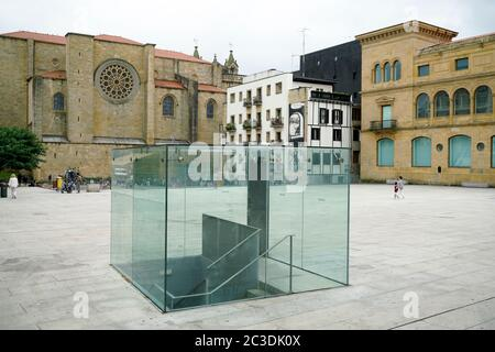 The 16th century Gothic style San Vicente Church with a glass cover of underground parking entrance in foreground.San Sebastian. Basque Country.Spain - Stock Photo