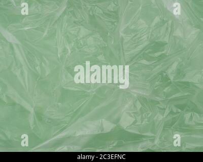 The texture of crumpled cellophane film. Abstract the image. The view from the top. Crumpled oilcloth.
