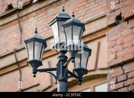 lantern on the background of a brick wall of the house on a city street - Stock Photo