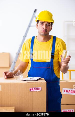 Young male professional mover doing home relocation - Stock Photo