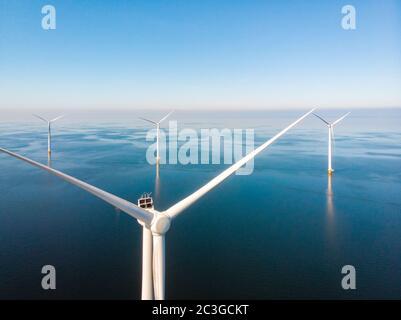 Wind turbine from aerial view, Drone view at windpark westermeerdijk a windmill farm in the lake IJsselmeer the biggest in the N