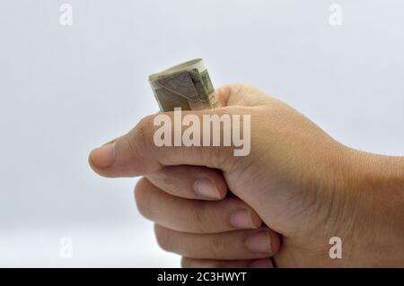 Man hand holding or grabbing money, indian rupees. - Stock Photo