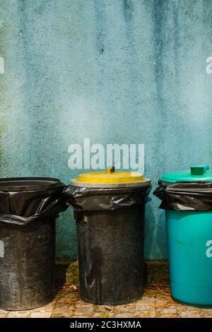 Recycking trash bins, blue grungy wall backgropund - Stock Photo