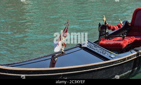 Gondola boats parking. Gondola moored, Venice, Italy. Italian gondola paddle boats docked in Venice, Veneto, Italy - Stock Photo