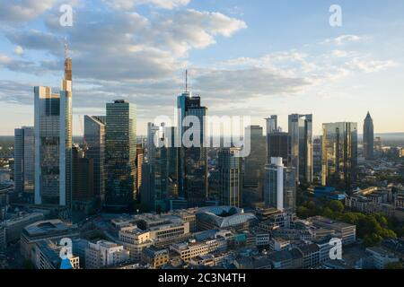 AERIAL Drone View over Frankfurt am Main, Germany Skyline in Beautfiful Afternoon Sunlight and Cloudscape in June 2020