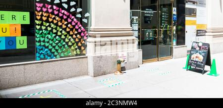 New York City, USA - 26 May 2020: A Starbucks has marked the sidewalk for customers to stand six feet apart waiting to order during the coronavirus CO - Stock Photo