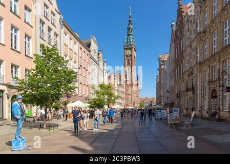 Gdansk, Poland - June 14, 2020: Crowded famous main street of the old town in Gdansk at sunny day