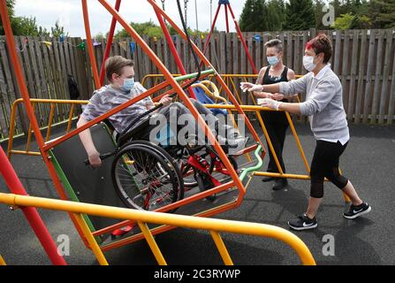 Gregor Marshall with his mum Karen alongside Early Years Practitioner Catherine Anderson (right) as Gregor has a ride on the wheelchair swing in the outside therapy area at the Craighalbert Centre. Coronavirus adaptations have been installed at the Scottish Centre for Children with Motor Impairments, Craighalbert Centre, Cumbernauld, as Scotland continues gradually lifting coronavirus lockdown measures.
