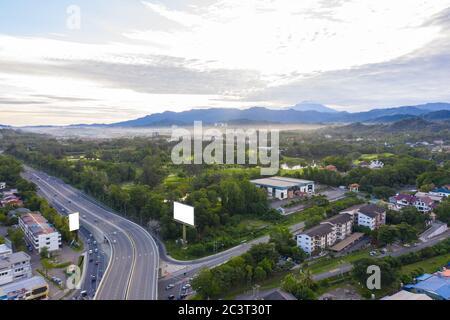Aerial image of car moving on Kota Kinabalu City, Sabah, Malaysia - Stock Photo
