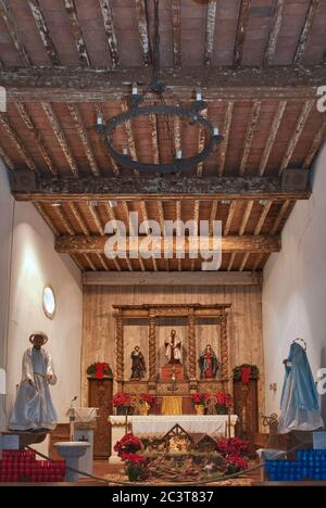 Church interior, before theft of Three Altar Statues, decorated for Christmas, at Mission San Juan Capistrano in San Antonio, Texas, USA - Stock Photo