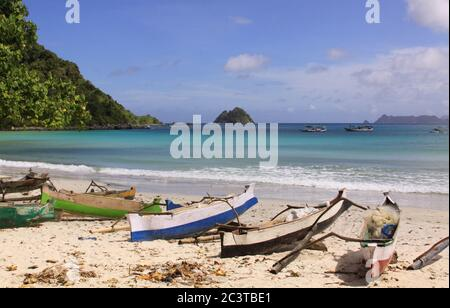 Small fishing boats at Mawun beach, Lombok. Kuta Lombok is an exotic paradise on the Indonesian island, with beautiful white sand beaches and crystal - Stock Photo