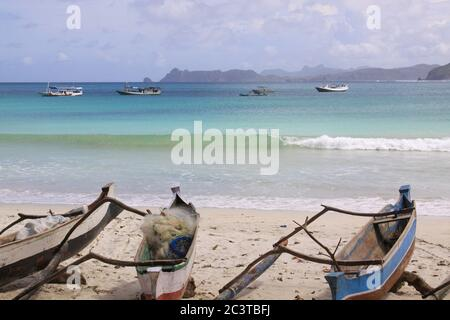 Small fishing canoes at Mawun beach, Lombok. Kuta Lombok is an exotic paradise on the Indonesian island, with beautiful white sand beaches and crystal - Stock Photo