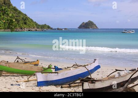 Jukung fishing boats at Mawun beach, Lombok. Kuta Lombok is an exotic paradise on the Indonesian island, with beautiful white sand beaches and crystal - Stock Photo