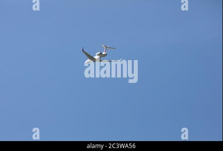 Biggin Hill,UK,22nd June 2020, Gulfstream G650ER departing London Biggin Hill Airport with a blue sky and light cloud formation. The weather today is 20C, sunny and a gentle breeze. The weather is for a heatwave as the week continues.Credit: Keith Larby/Alamy Live News - Stock Photo