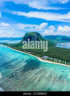 Aerial panoramic view of Mauritius island - Detail of Le Morne Brabant mountain with underwater waterfall perspective optic illusion - Wanderlust and