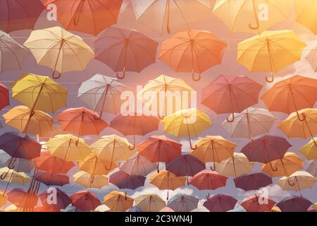 wallpaper with umbrellas in clear blue sky - Stock Photo