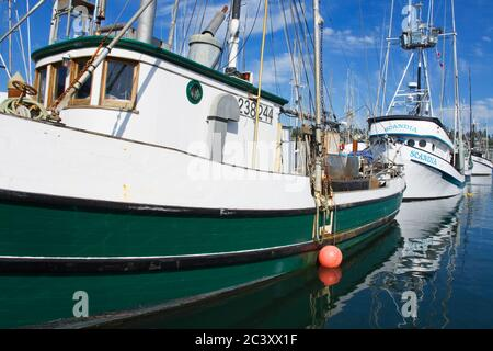 Commercial fishing boats in the bay front area of Newport - Stock Photo