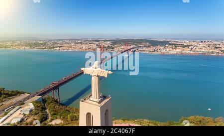 Aerial bridge on April 25th, statue of Jesus Christ Lisbon, Portugal. Historical memo. Close-up.