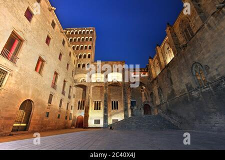 The medieval Placa del Rei in Barcelona, Spain at night.