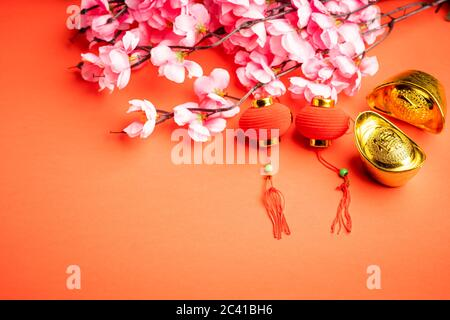 """Chinese New Year background. The wordings on gold bar is chinese words which means """"to bring in wealth and treasure"""""""