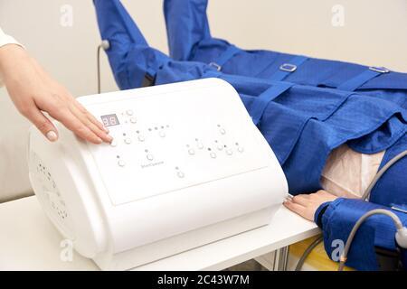 Alternative body treatment. Anti fat massage pressotherapy - Stock Photo