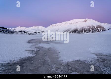 Piano Grande of Castelluccio di Norcia plateau and Vettore in winter, Umbria, Italy - Stock Photo