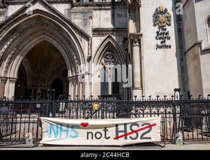 London, June- 2020: An anti HS2 banner outside the Royal Courts of Justice in reference to the controversial large rail infrastructure project