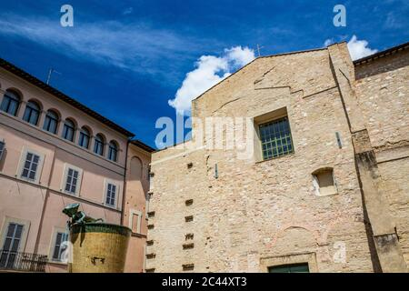 An ancient brick building in the historic center of Foligno. The blue sky on a hot summer day. Perugia, Umbria, Italy. - Stock Photo