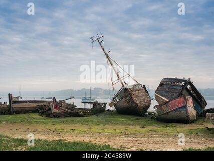 Views of boat wrecks at Pin Mill on the River Orwell just outside Ipswich, Suffolk, UK. Famous for its boat wrecks and great for photographers. - Stock Photo