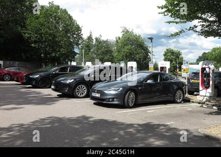 Tesla electric cars charging at South Mimms services, M25
