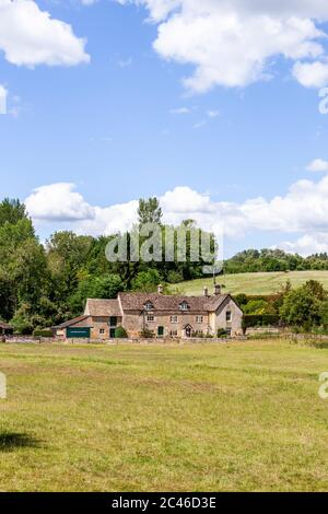 The Coln Valley - looking across to Yanworth Mill beside the River Coln near the Cotswold village of Yanworth, Gloucestershire UK