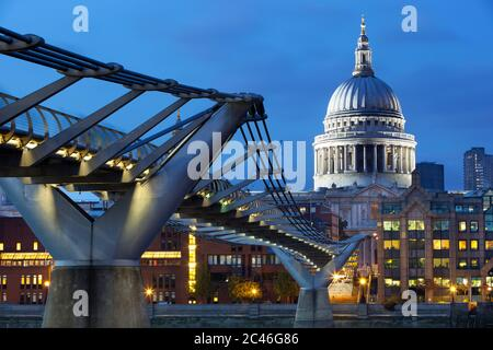 Millennium Bridge over River Thames and St Paul's Cathedral at dusk, London, England, United Kingdom, Europe