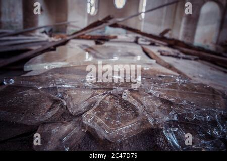 Pieces of ice lying on the wooden boards - Stock Photo