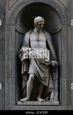 Statue of Nicola Pisano, italian famous sculptor, outdoor the Uffizi Museum building in Florence, Tuscany, Italy - Stock Photo