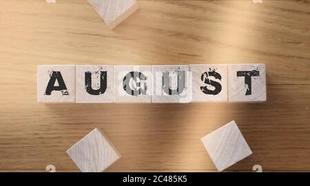 August word written on wood block on wooden table Events schedule concept - Stock Photo