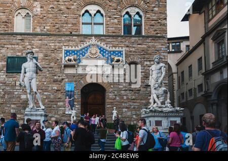 Statues of David and Hercules and Cacus at entrance of Palazzo Vecchio on Piazza della Signoria (Signoria square) in Florence, Italy - Stock Photo