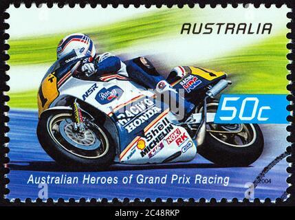 AUSTRALIA - CIRCA 2004: A stamp printed in Australia from the 'Australian Heroes of Grand Prix Racing' issue shows Wayne Gardner (Rothmans Honda) - Stock Photo